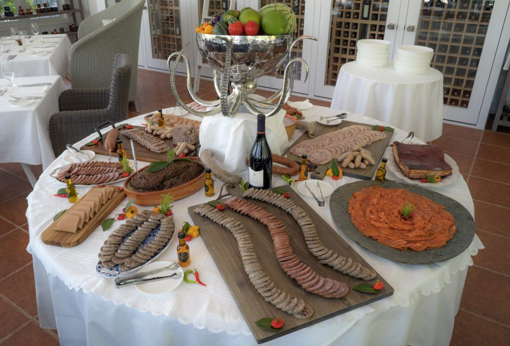 An impressive homemade charcuterie spread is presented in the main dining room.