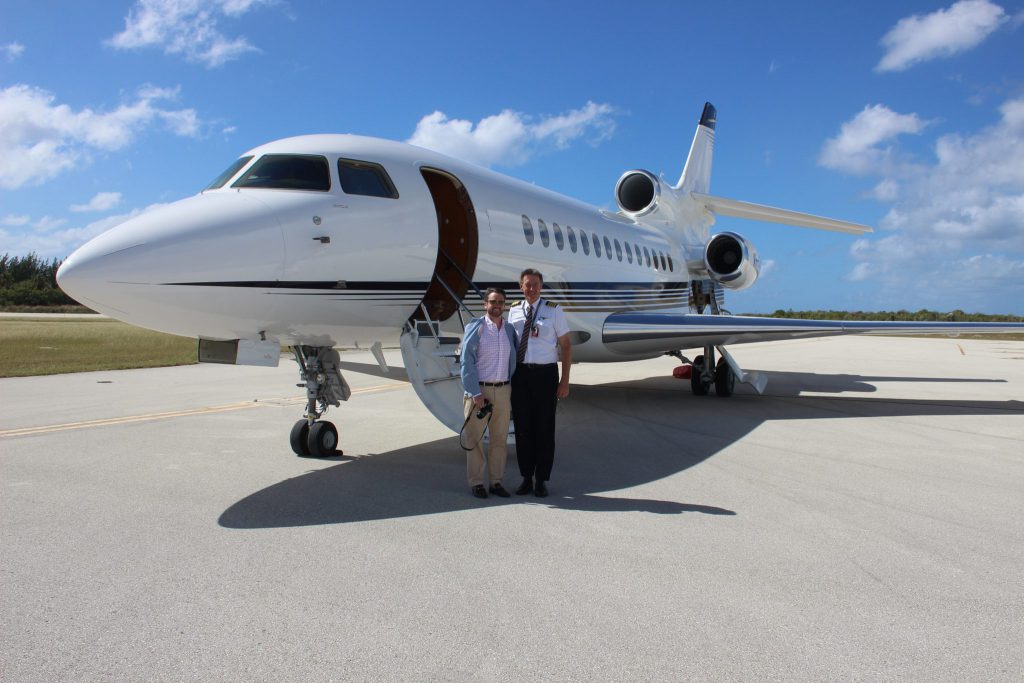 Michael Kennedy, owner of Component Wine Company, and pilot Bruce Perey take a moment by Terry Peabody's Falcon 7X jet – our transportation for the day.