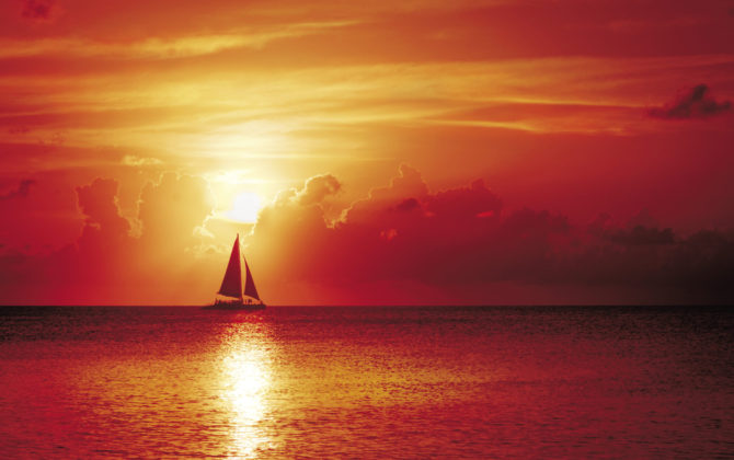 What better way to end the day than sailing into the sunset off Seven Mile Beach . . . Photo By Stephen Clarke
