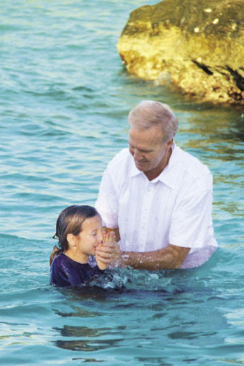 A young member of the congregation is baptized.
