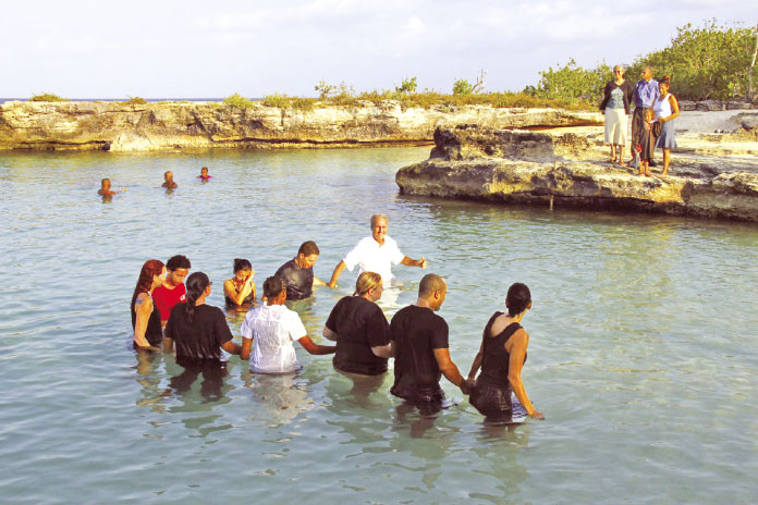 Pastor Randy leads a baptism at Smith Cove.