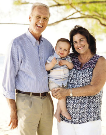 Pastor Randy and wife Cindy with their grandson Clark Landon Gibson.