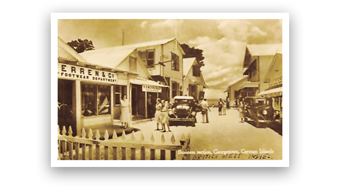Old postcard showing George Town's Shedden Road circa 1950.