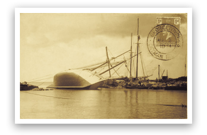 A postcard showing two schooners called Arbutus and Lydia E. Wilson being careened, postmarked 1934.