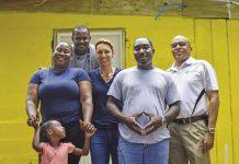 Tara Nielsen (center) with Treasan Myles, Kelana Cousins and Cayman Casa volunteers.