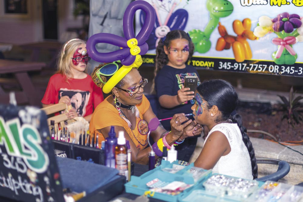 Cayman Face Painters, painting for a cause.